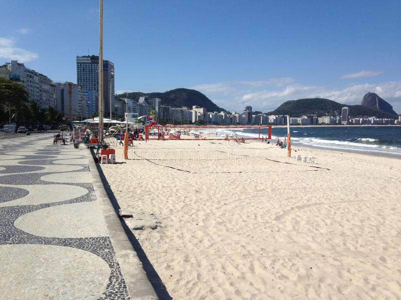 Brazils golden sandy beaches and volleyball in rio. Brazil Rios golden sandy beaches, sea, sand and sun in this country it more special and beautiful royalty free stock images