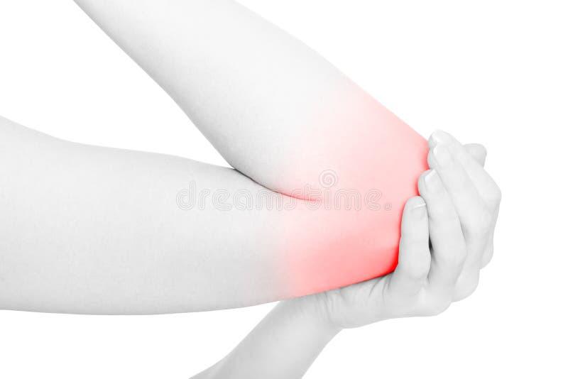 Brazo de la mujer con área y la mano rojas del dolor del codo en blanco imagenes de archivo