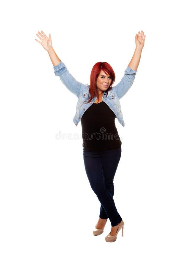 Brazos que agitan de la mujer feliz en el aire foto de archivo libre de regalías
