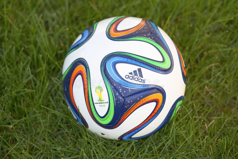 Brazuca soccer ball on grass stock photo