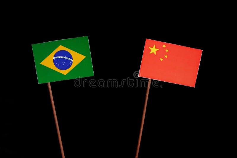 Brazylijczyk flaga z chińczyk flaga odizolowywającą na czerni zdjęcie royalty free