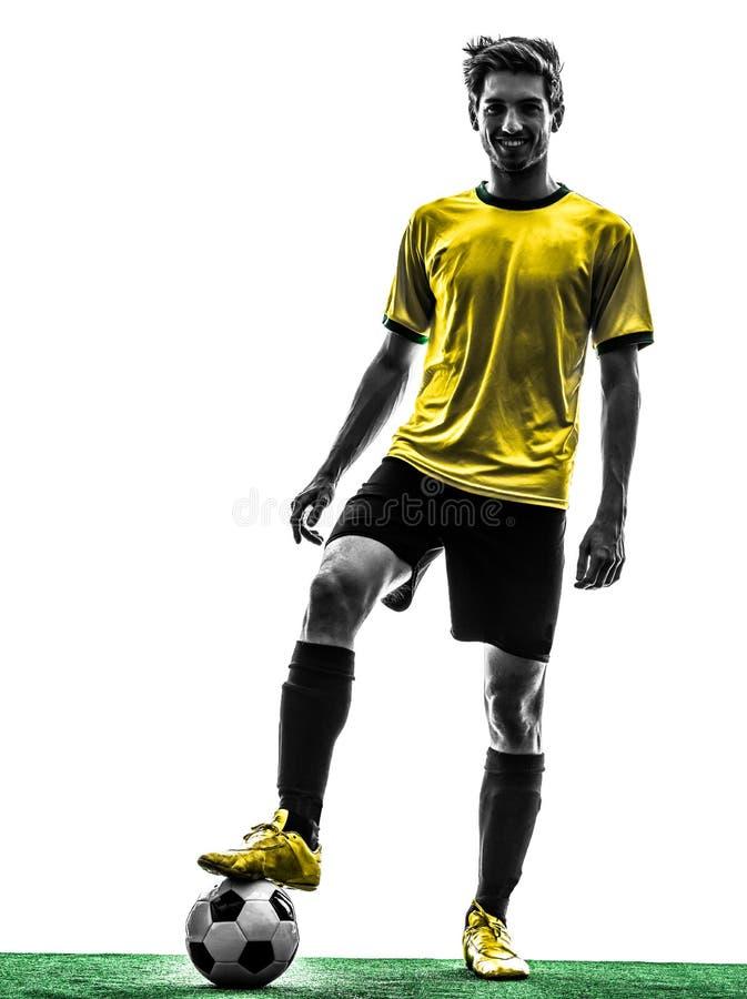 Brazylijska piłka nożna gracza futbolu młodego człowieka sylwetka zdjęcie royalty free
