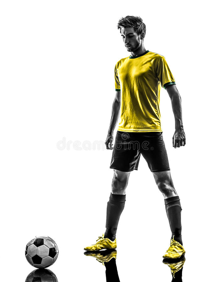 Brazylijska piłka nożna gracza futbolu młodego człowieka sylwetka fotografia stock