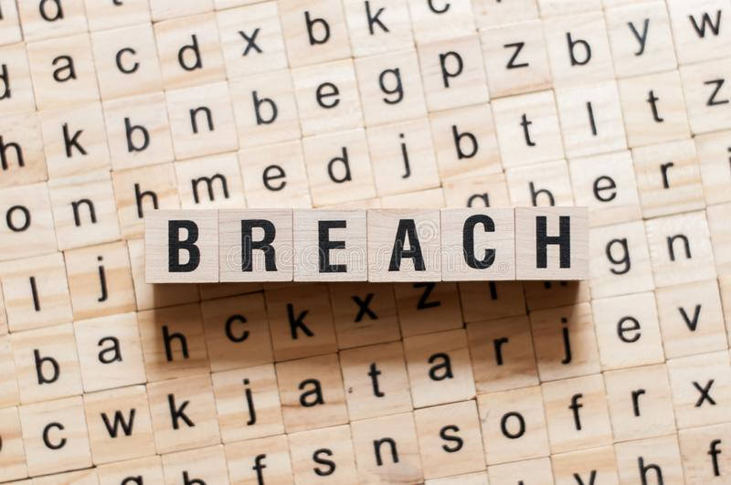 Breach word concept. On cubes stock photo