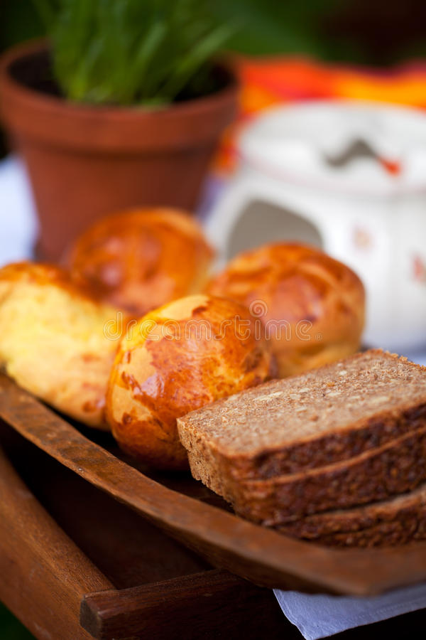 Bread. Slices of bread on a wooden plate royalty free stock image