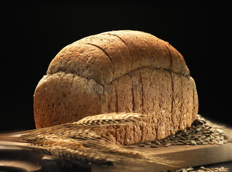 Bread. Loaf of bread and wheat in low key lighting
