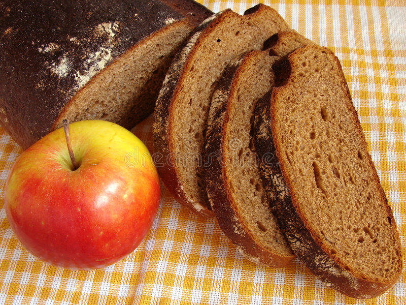 Bread and apple stock images