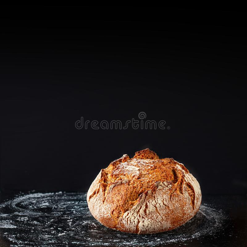 Bread background. Fresh bread on dark board. Close-up. Bakery concept. Rustic style royalty free stock photography