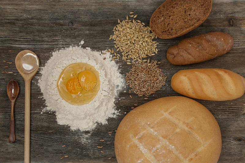 Bread and bake with spices on the kitchen table. Bread, bake, flour, agg and corn with spices on the kitchen table royalty free stock photo