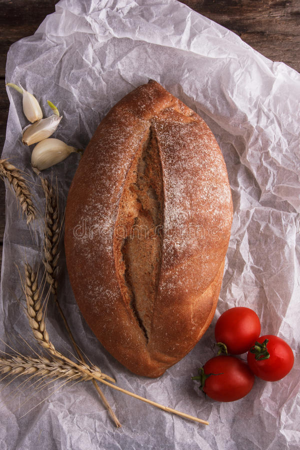 Bread on a baking paper royalty free stock image