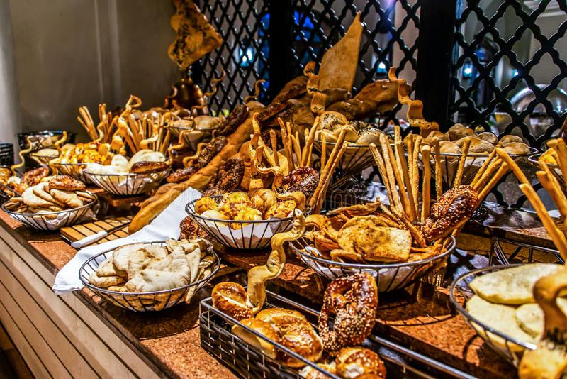 Bread bar station buffet catering, close-up Assortment of fresh pastry on table Pastry buffet set for breakfast in Egypt royalty free stock images