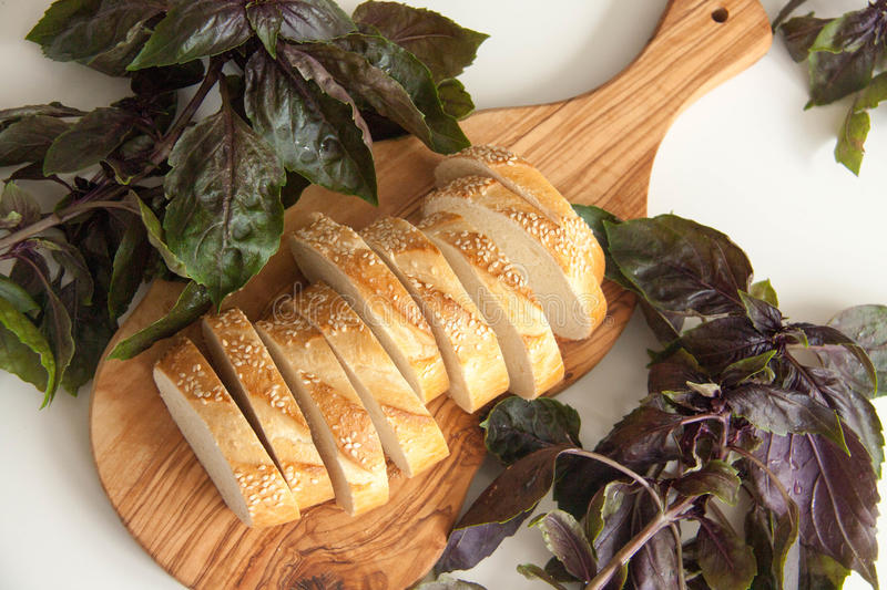 Bread and basil royalty free stock photography