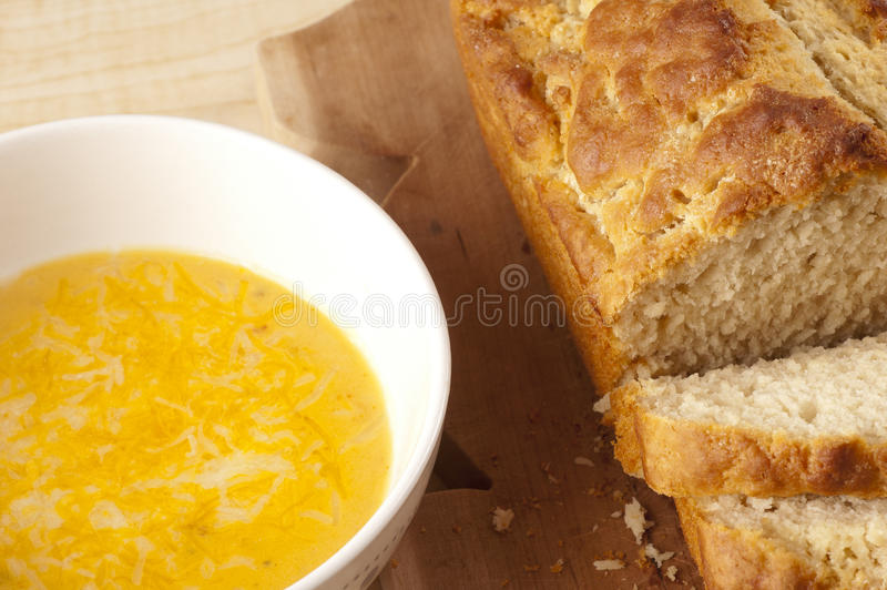 Bread and Beer Cheese Soup. On Wooden Table stock photo