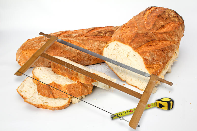 Bread big. Great bread and sliced ​​with a saw royalty free stock photography