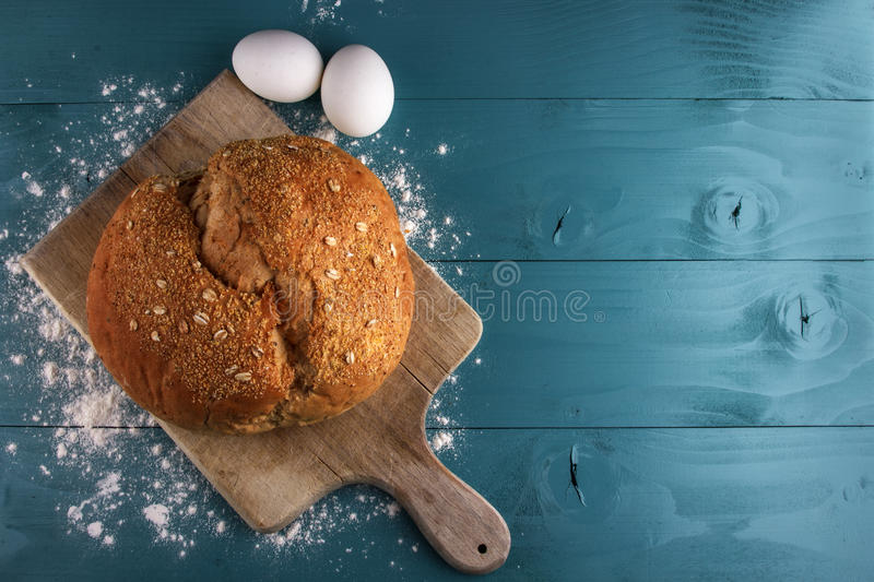 Bread on a blue wooden board stock photography