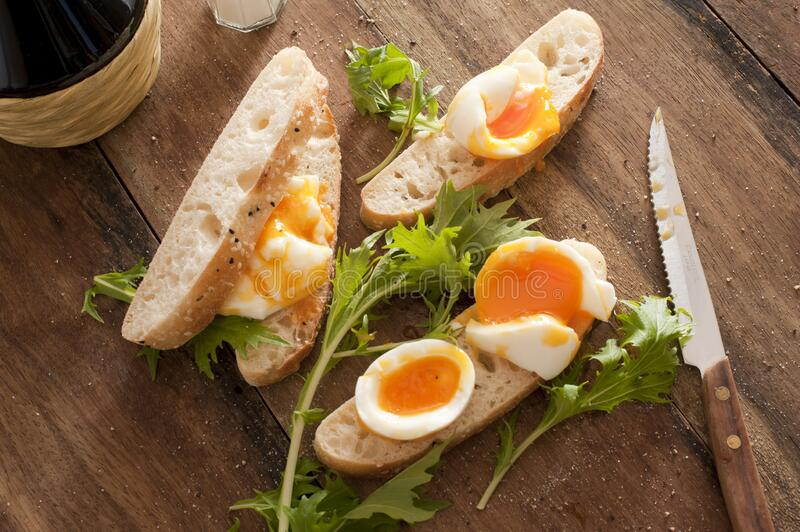 Bread with boiled eggs and salad royalty free stock photos
