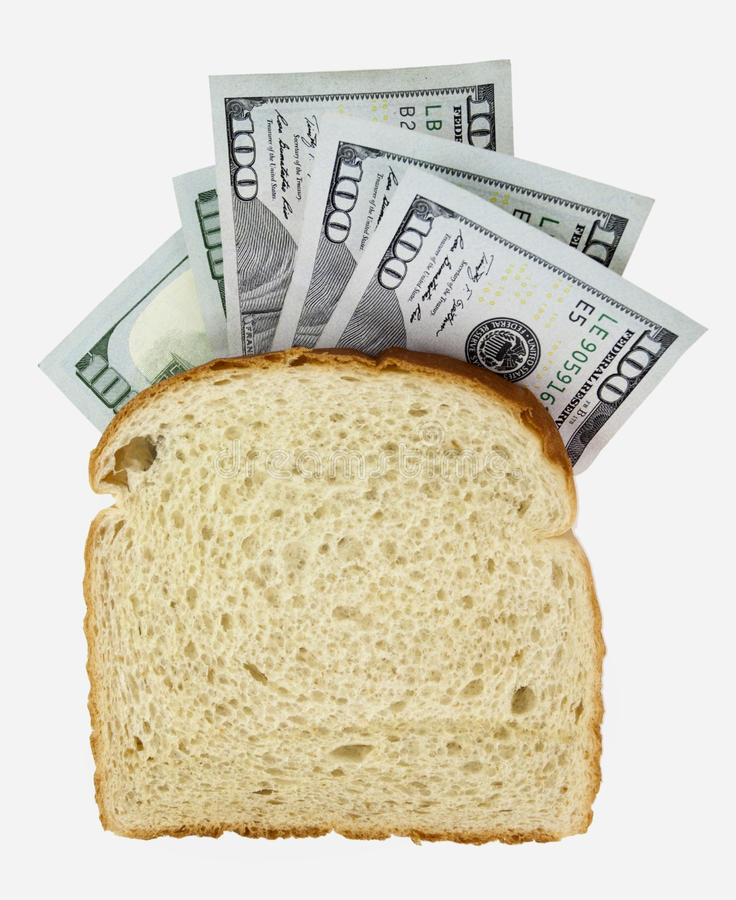 Bread-Bread. Slice of whole wheat bread with hundred dollar bills. Isolated stock image