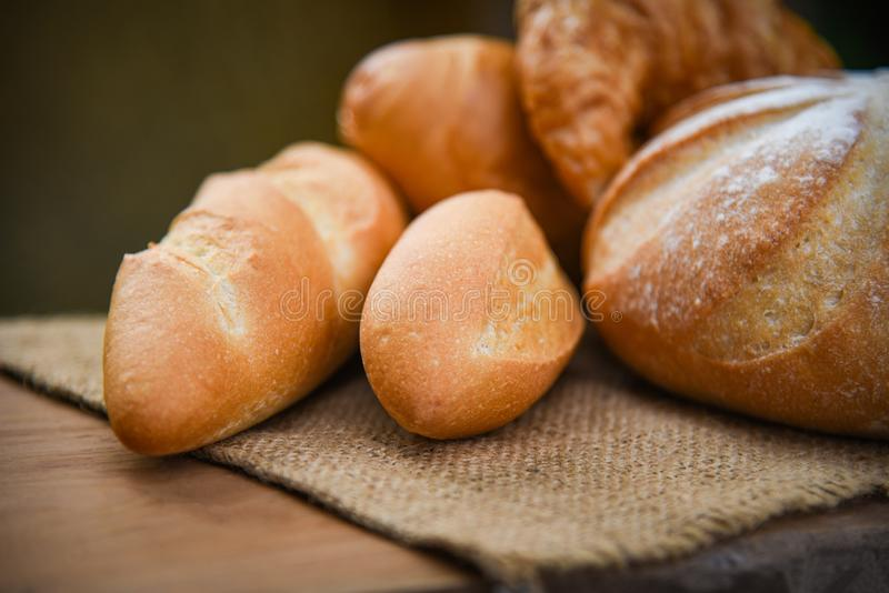 Bread and buns assortment / Fresh Bakery bread various types on sack in the rustic table homemade breakfast food stock image