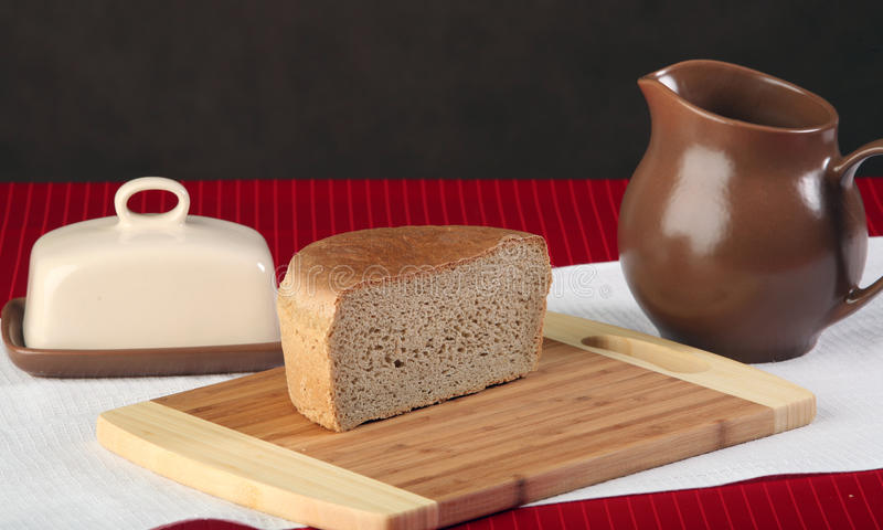 Bread. Close-up of sliced bread on a cutting board and other edibles studio stock photography