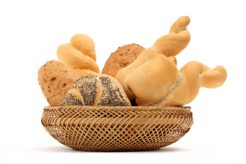 Bread composition of various rolls in a basket on white stock image