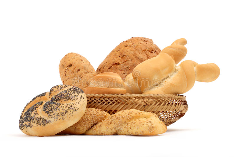 Bread composition of various rolls in a basket on white royalty free stock photography