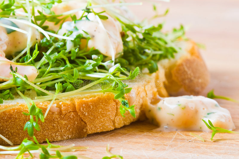 Bread, cress and prawns stock image