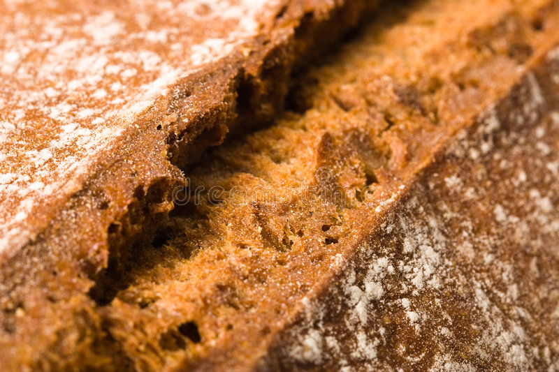 Bread crust. Macro image with the crust of a brown bread stock image
