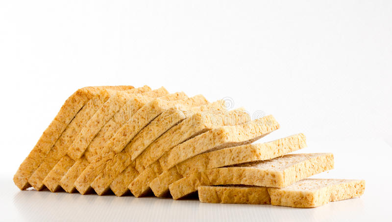 Bread cut. The bread cut on white background stock photography