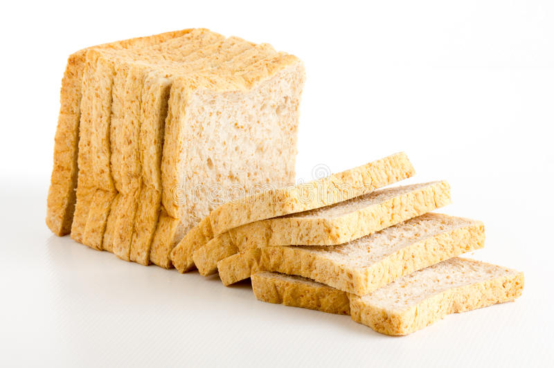 Bread cut. The bread cut on white background stock photos