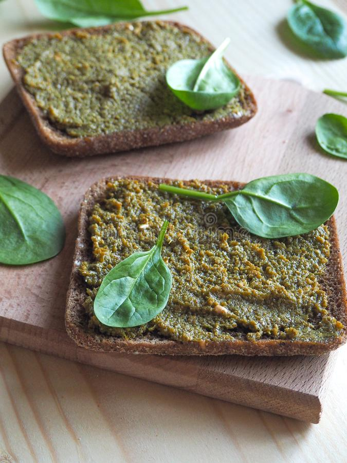 Bread with a delicious sauce of spinach. stock photos