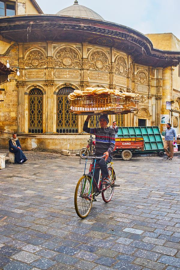 Bread deliverer in Islamic Cairo, Egypt stock photography
