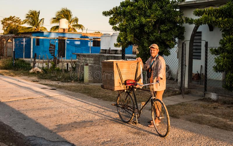 Bread Delivery Man. La Boca, Cuba - March 15, 2016: Cuban man delivers bread every morning in the rural town of La Boca using a bicycle equipped with a storage royalty free stock image