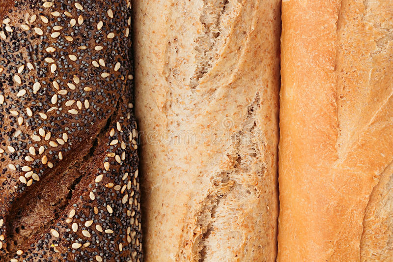 Bread of different varieties view from above. Rye, wheat and whole grain bread. Macro. Texture. Food background stock photos