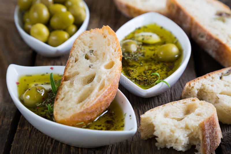 The bread dipped in olive oil with herbs and spices royalty free stock photography