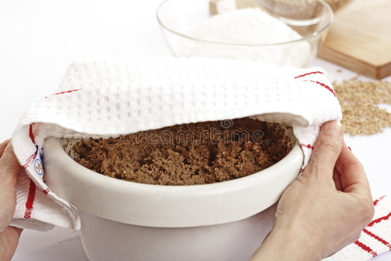Bread dough covered with dish towel royalty free stock image