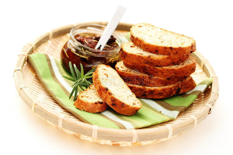 Bread with dry tomatoes stock image