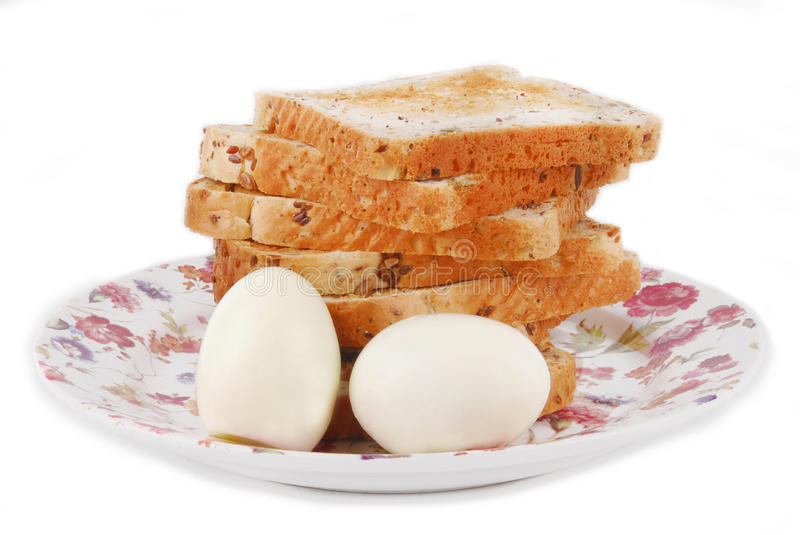 Bread with eggs on plate stock photo