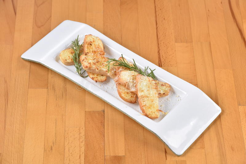 Bread with Garlic. French Bread Toast with Garlic stock photo