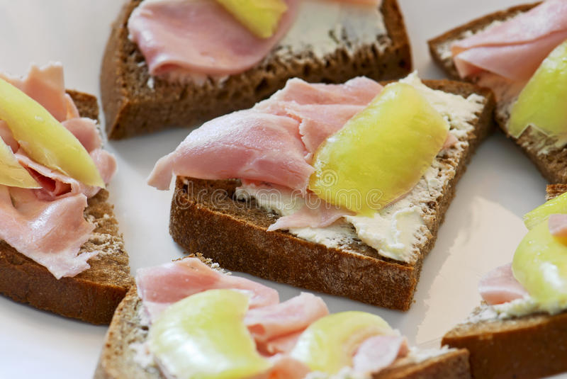 Bread with ham and peppers royalty free stock image
