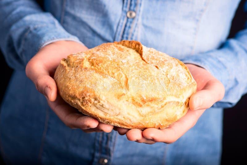 Bread in hands stock photos