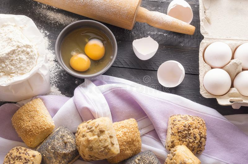 Bread ingredients and homemade buns royalty free stock image