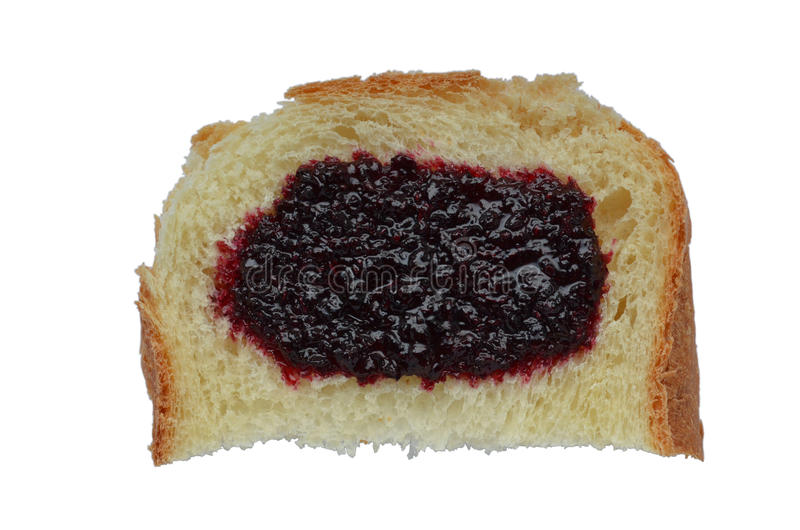 Bread with jam from the black currant isolated on white stock images
