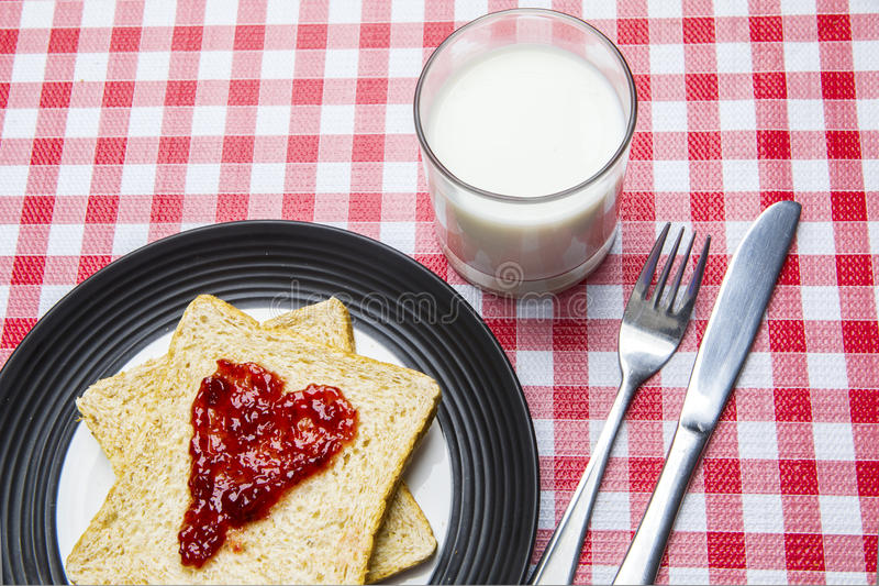 Bread with jam and milk stock photos