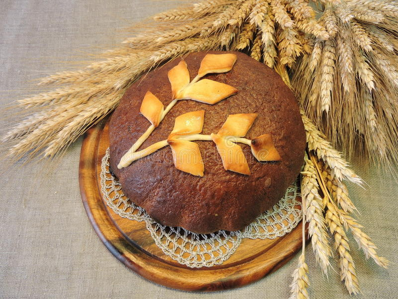 Bread loaf and grain ears stock images