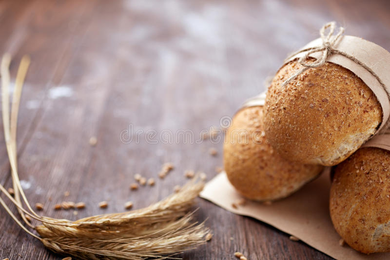 Bread loaf rustic selection of rye, soda, bloomer breads, with granary and oated rolls and ears of wheat. Natural products. Delicious food. Bread and baked royalty free stock image