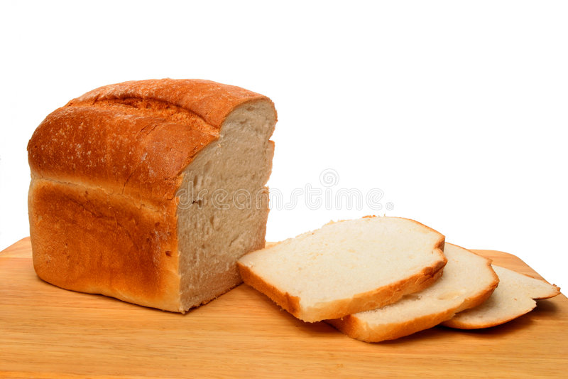 Bread loaf and slices royalty free stock photography