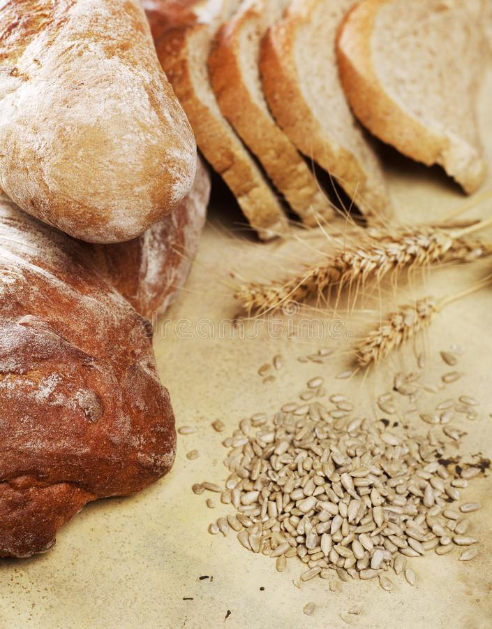 Bread loafs and grain stock photo