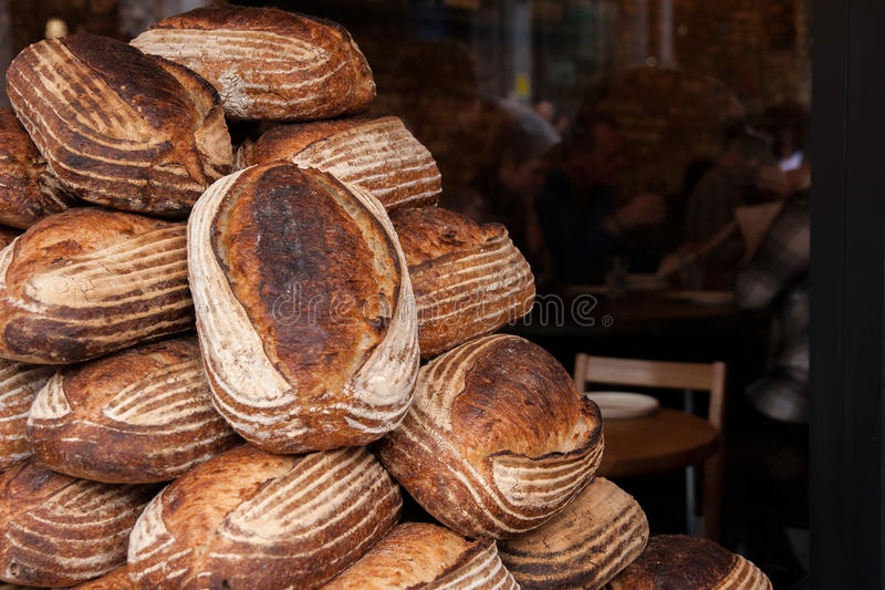 Bread loafs on pile royalty free stock photos