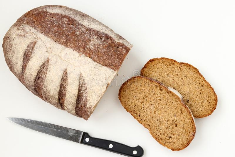 Bread made from whole grain flour located on a white background. Top view stock images