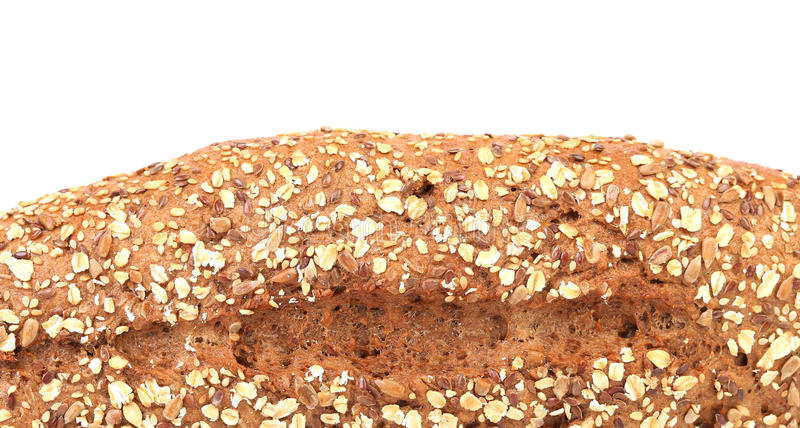 Bread made from whole grain. Isolated on a white background. Place for text royalty free stock image
